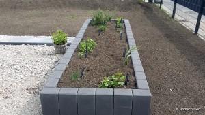 Bepflanztes Hochbeet aus Paliadensteinen